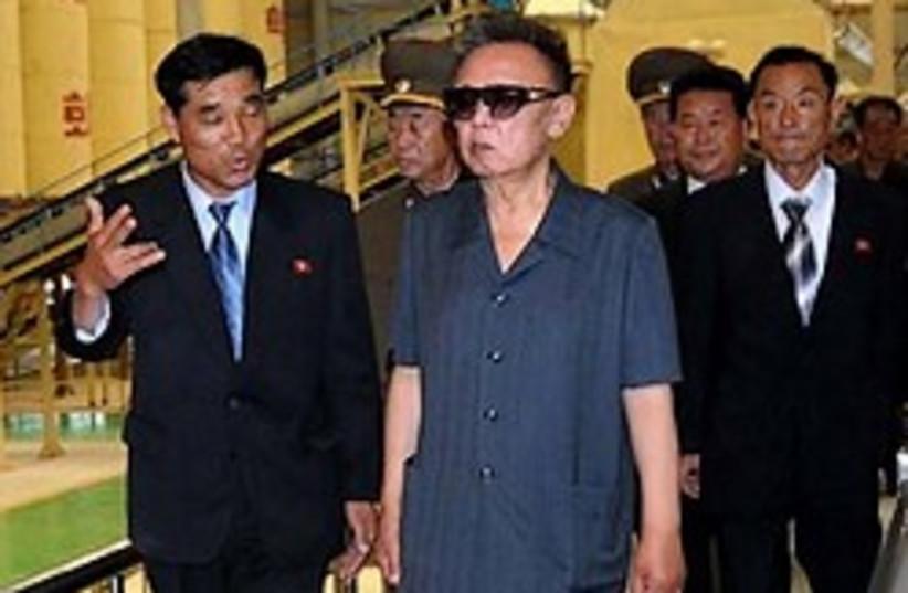 kim korea visits factory 248.88 ap (photo credit: AP)