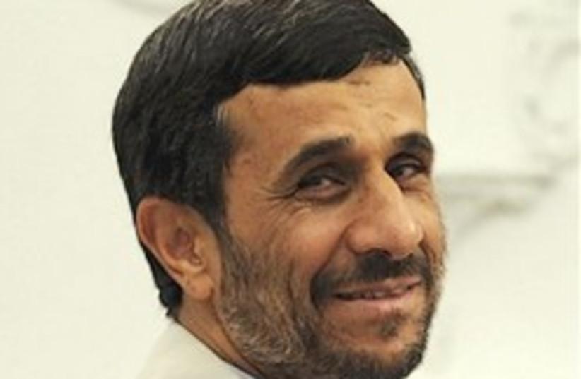 ahmadinejad smiles 248.88 (photo credit: AP)
