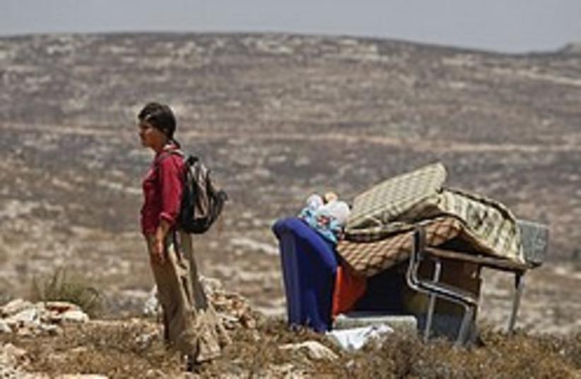 settler demolished outpost 248.88 (photo credit: AP)