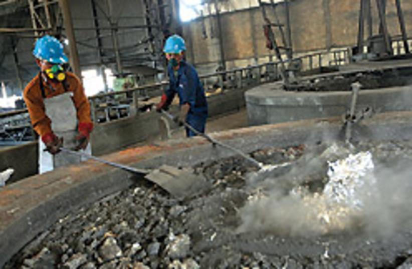metal workers 88 248 (photo credit: Bloomber)