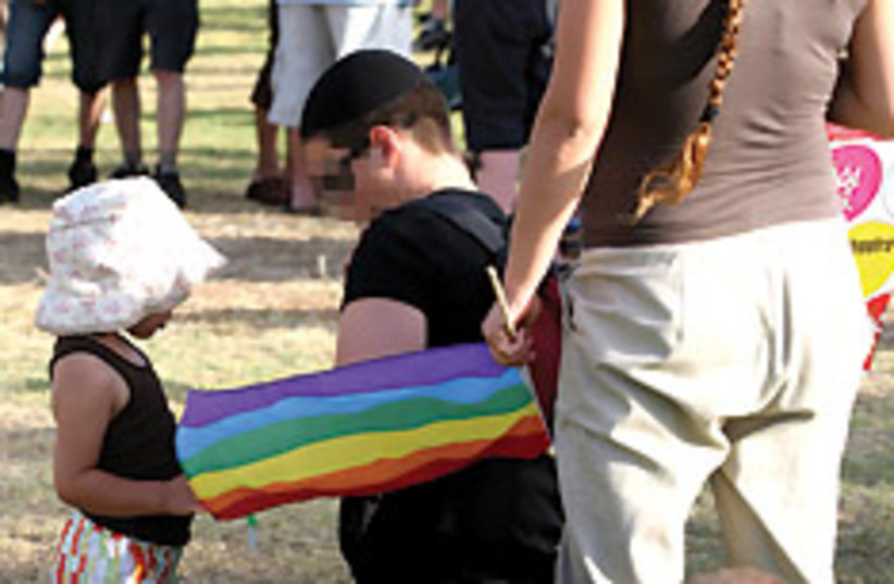 gay with child 88 248 (photo credit: Ariel Jerozolimski)