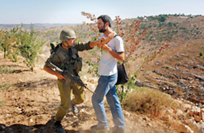 army protestor scuffle 88 248 (photo credit: )
