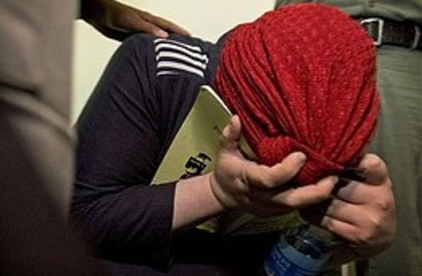 child-starving mother hides 248.88 (photo credit: AP)
