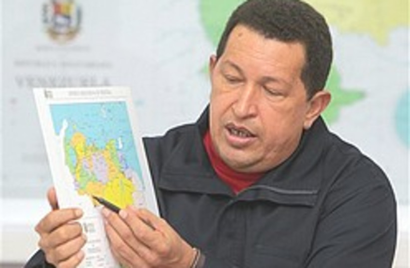 Chavez points to a map 248.88 (photo credit: AP)