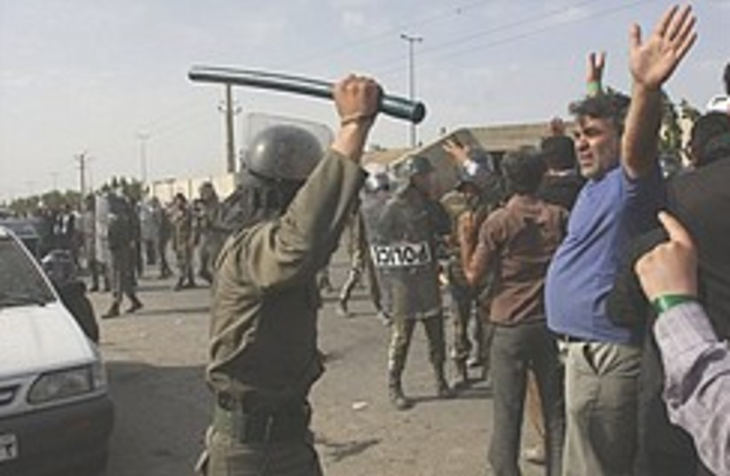 Iran police hit protesters  248.88 (photo credit: AP)