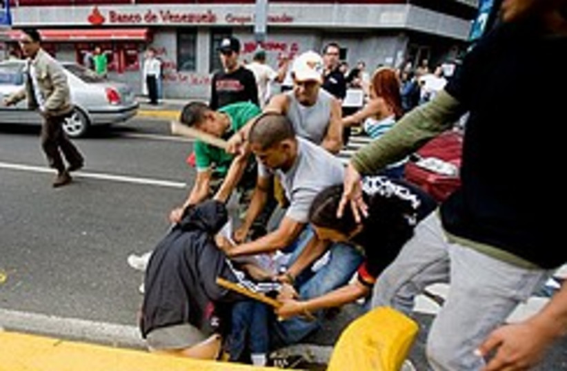 Chavez supporters attack journalist 248. (photo credit: AP)
