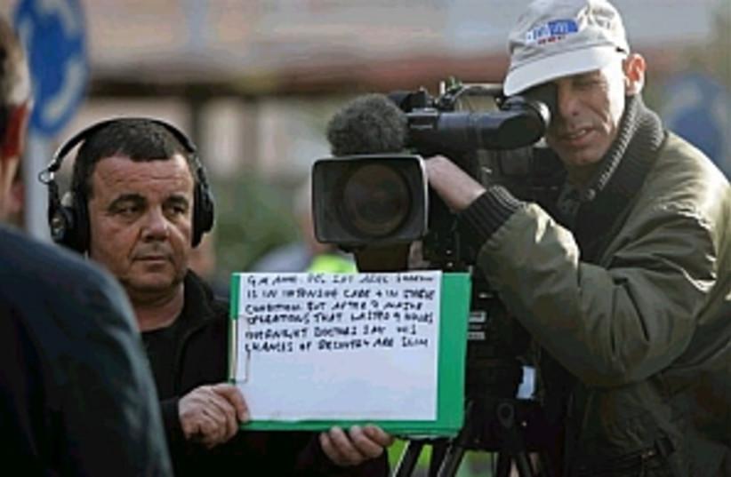 camera crew 298 ap (photo credit: AP [file])