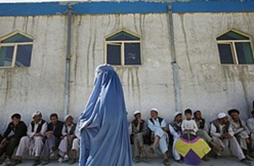 Afghan woman voter 248.88 (photo credit: )