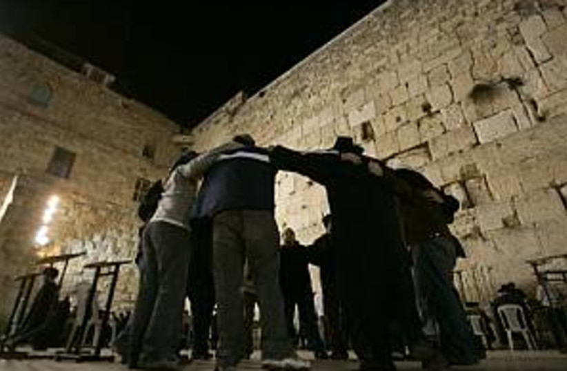 jews huddle at kotel 298 (photo credit: AP [file])