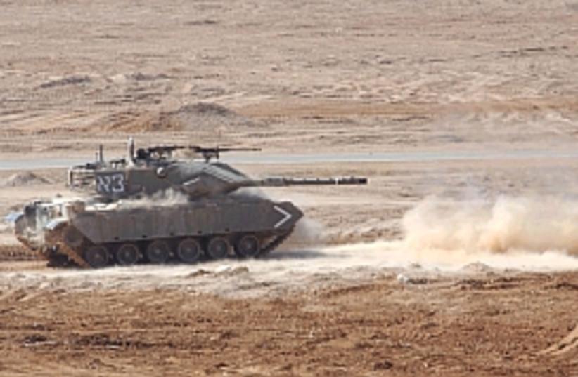 tank drives in dirt 298 (photo credit: Ariel Jerozolimski)