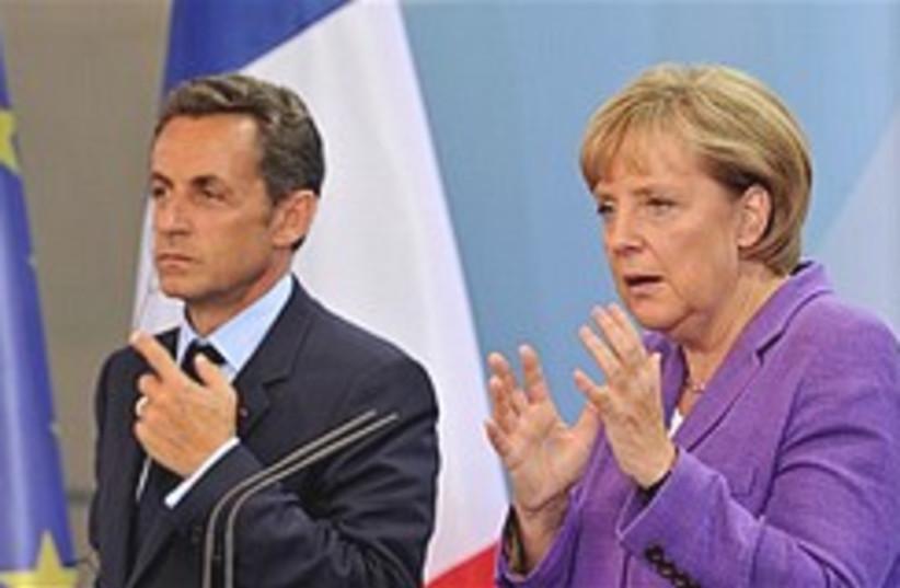 Merkel and Sarkozy gesture 248.88 (photo credit: )