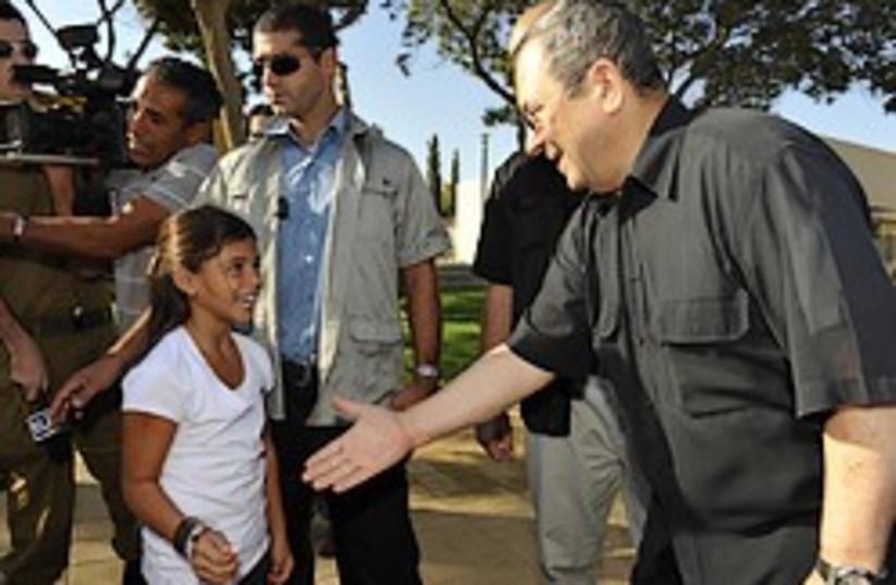 Barak shakes hand girl 248 mod (photo credit: Defense Ministry)
