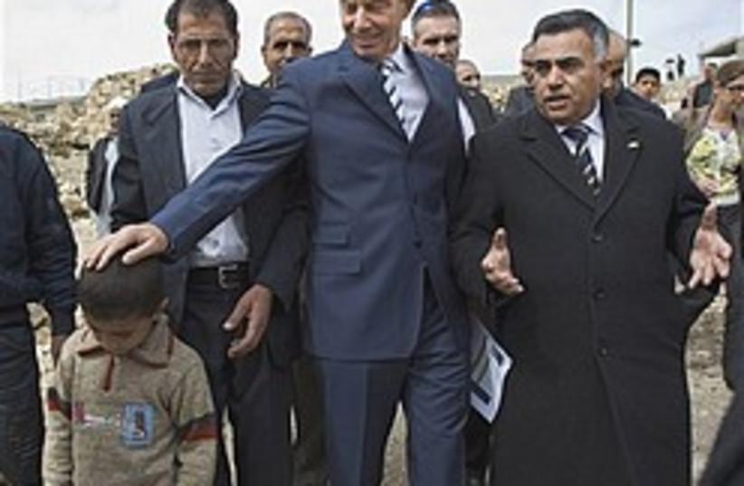 blair touched Palestinian boy 248.88 (photo credit: AP)