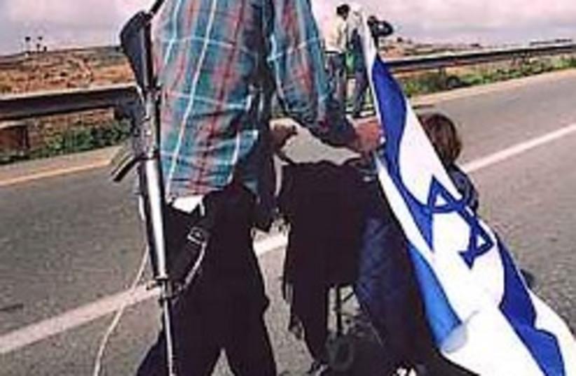 settler marches 248.88 (photo credit: AP)