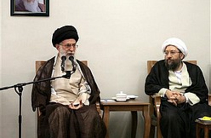 Khamenei sits 248.88 (photo credit: AP [file])