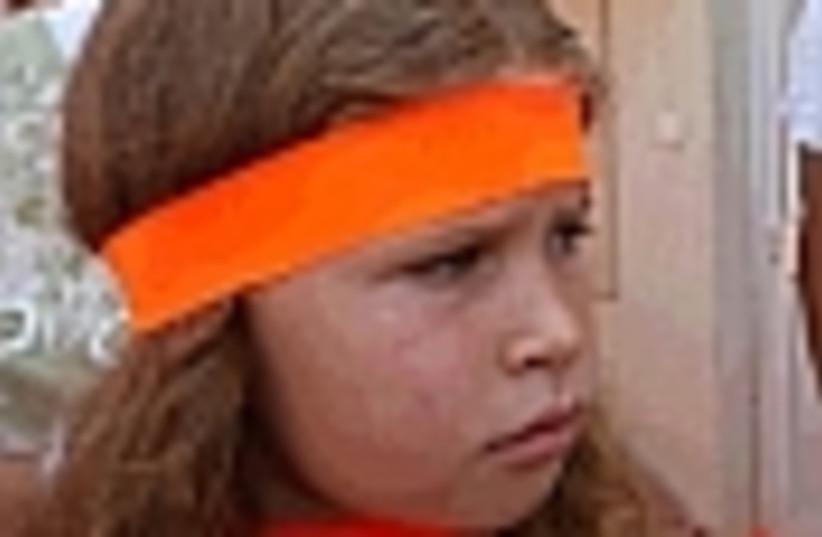 orange headband girl 88 (photo credit: )
