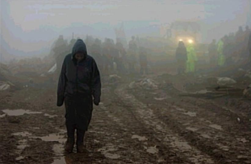 alone settler in wet haz (photo credit: AP)