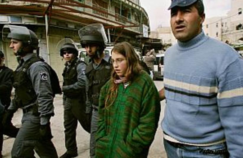 police arrest settler  (photo credit: AP)