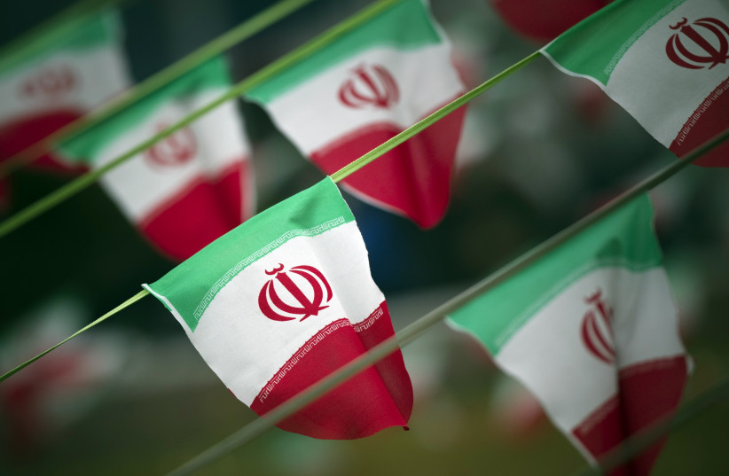Iran's national flags are seen on a square in Tehran [File] (photo credit: REUTERS)