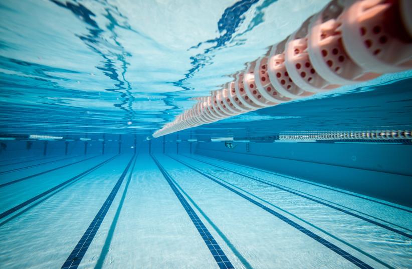 swimming pool under water illustrative (photo credit: INGIMAGE)