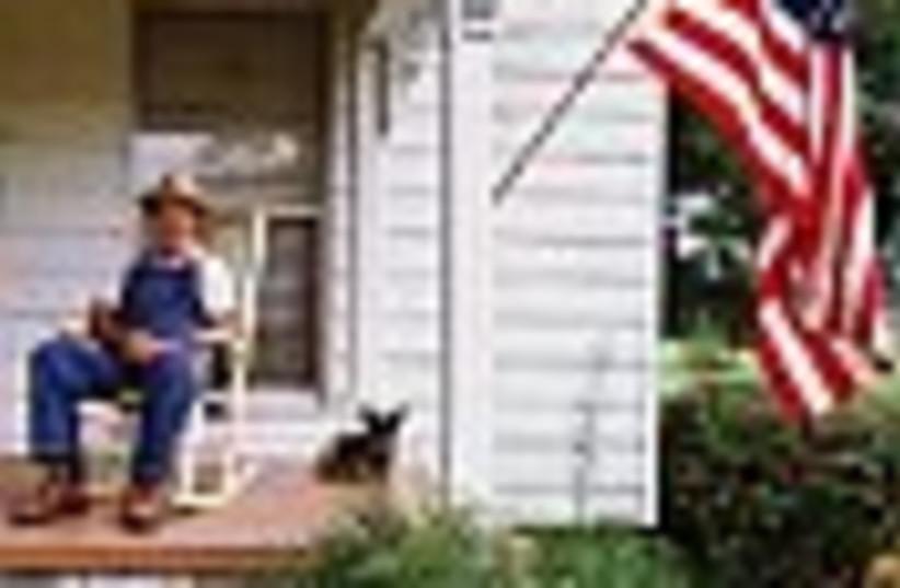 man on porch 88 (photo credit: )