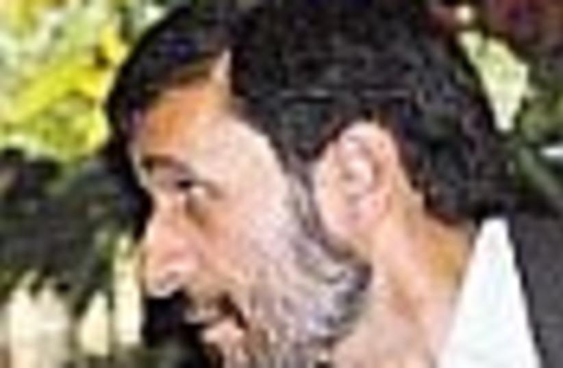 ahmadinejad leaning 88 (photo credit: )