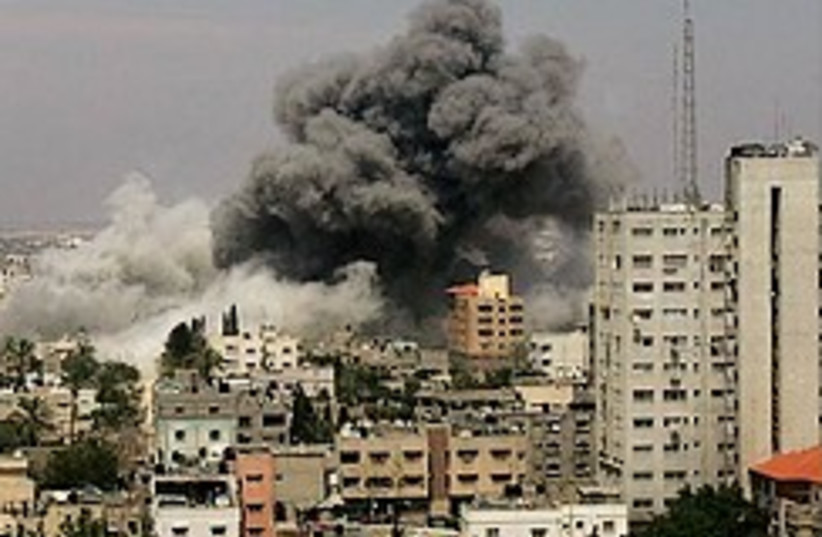 The aftermath of an IAF strike in Gaza (photo credit: AP)