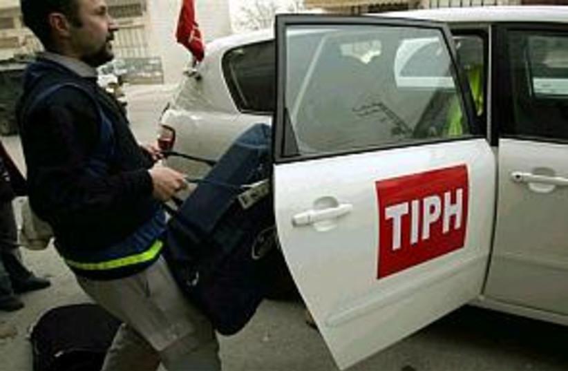 tiph car leaves hebron (photo credit: AP)