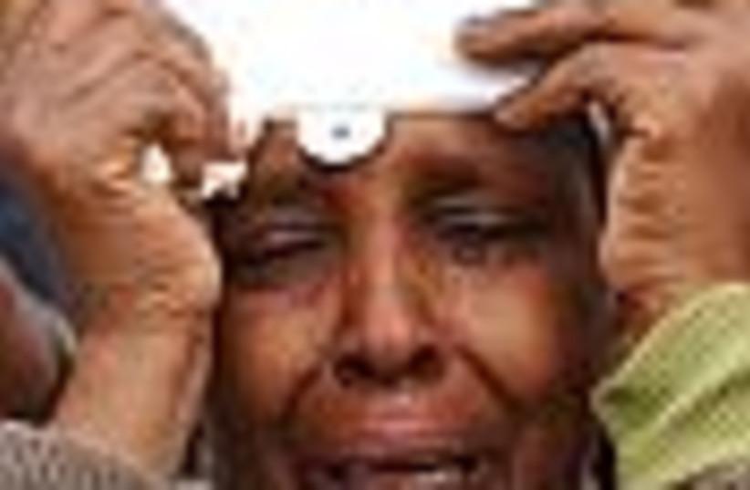 ethiopian woman crying88 (photo credit: )