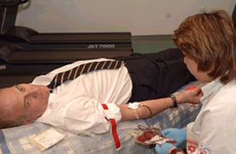 olmert gives blood 298 (photo credit: GPO)