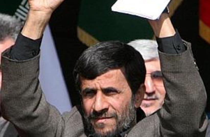 ahmadinejad, hands in ai (photo credit: AP [file])