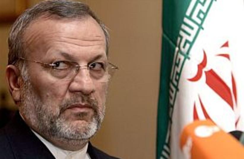 iran fm mottaki mean 298 (photo credit: AP [file])