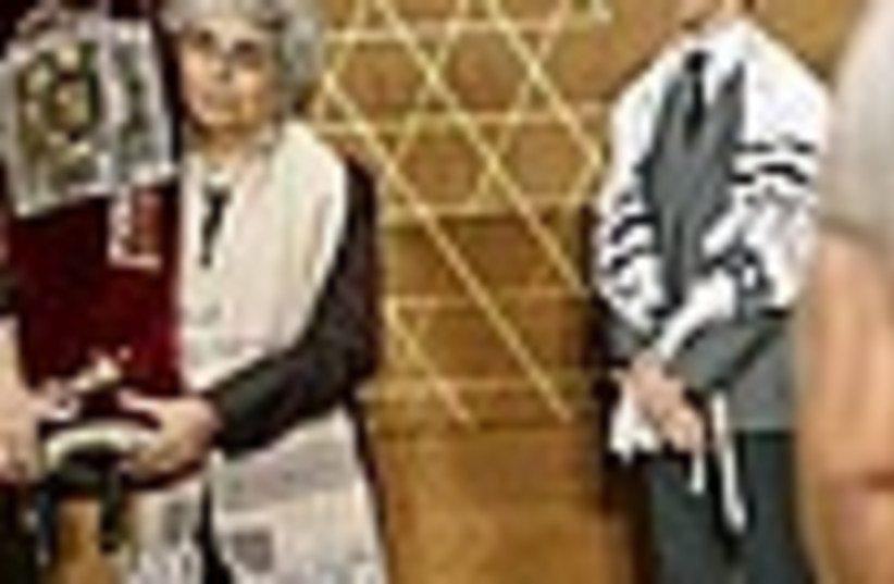 woman holding torah 88 (photo credit: )