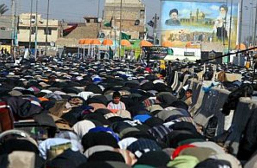 iraq prayer 88.298 (photo credit: AP)