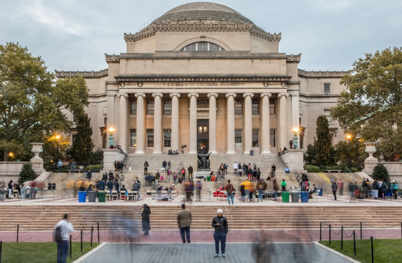 "(photo credit: TONY CENICOLA/ THE NEW YORK TIMES ""THE LIBRARY AT COLUMBIA UNIVERSITY"")"