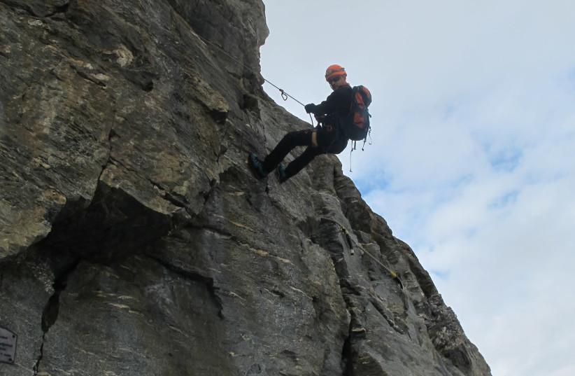 Climbing a steep ledge (photo credit: YORAM KRAUS)