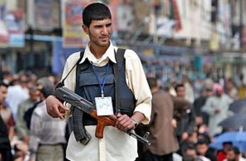 iraq militiaman 298 (photo credit: AP)