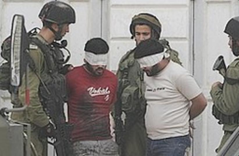 Troops arrest Palestinians 248.88 (photo credit: )