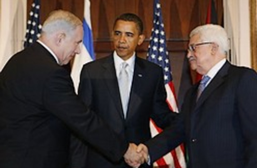 netanyahu abbas shake hands 248 88 (photo credit: )