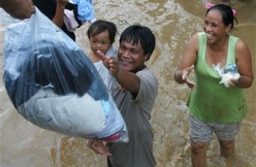 flood philipines 248.88 (photo credit: AP)