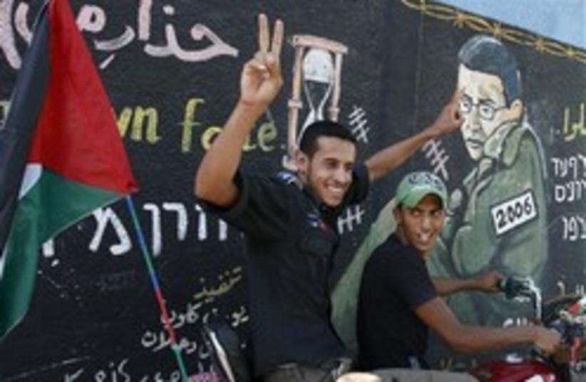 gazans gloat schalit 248.88 (photo credit: AP)