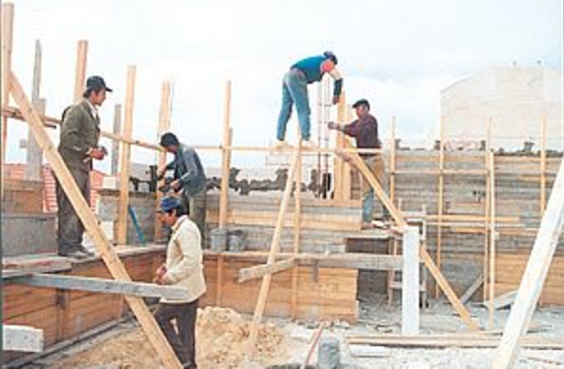 workers building 88.298 (photo credit: )