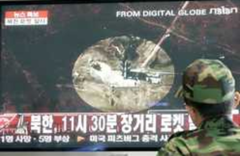 north korea missile (photo credit: AP)