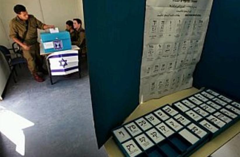soldier voting 298 88 ap (photo credit: AP)