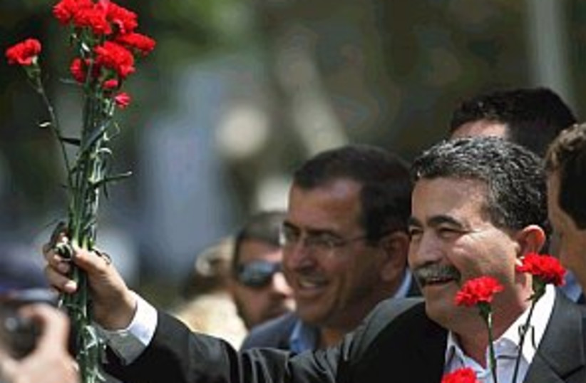 peretz campaigning 298.8 (photo credit: Associated Press)