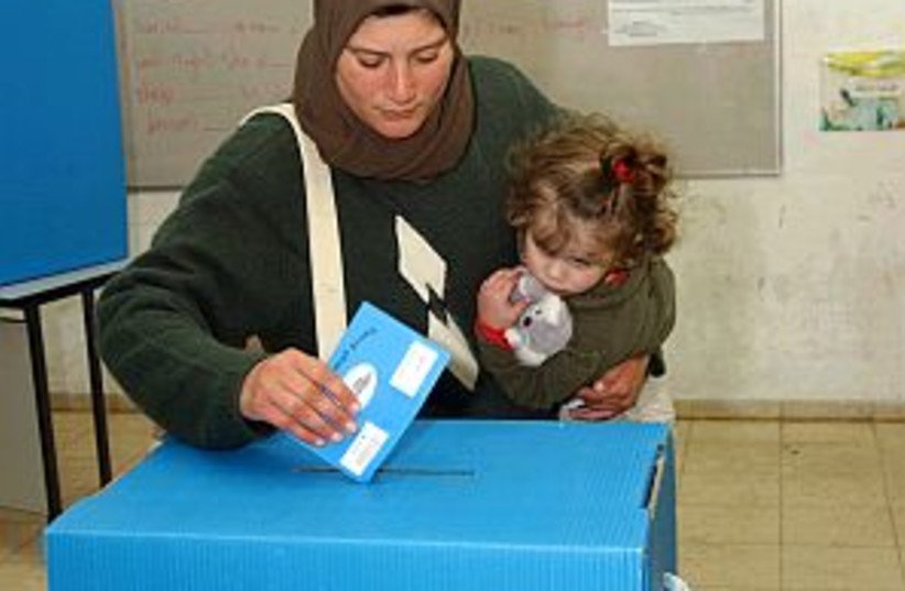 arab woman, child vote (photo credit: Ariel Jerozolimski )
