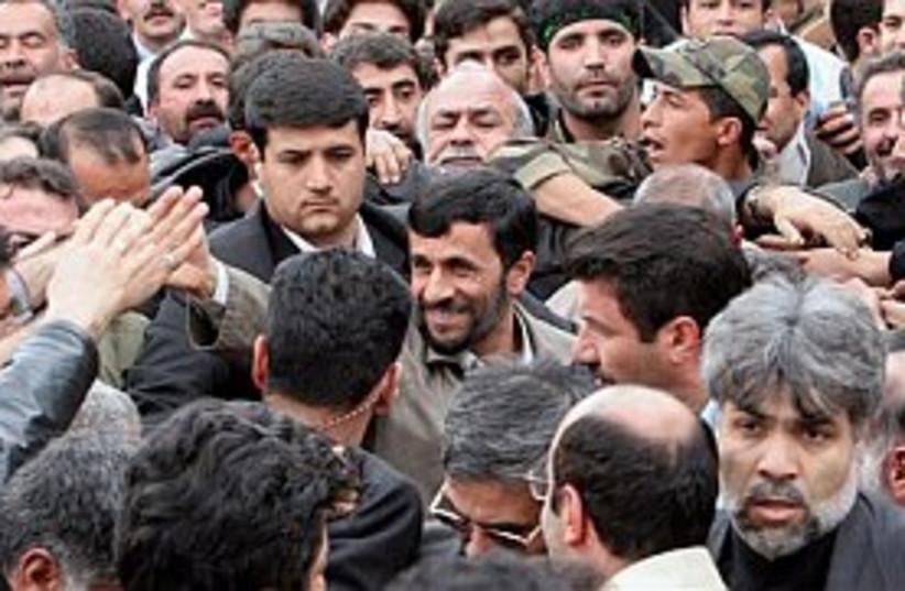 ahmadinejad surrounded b (photo credit: AP)