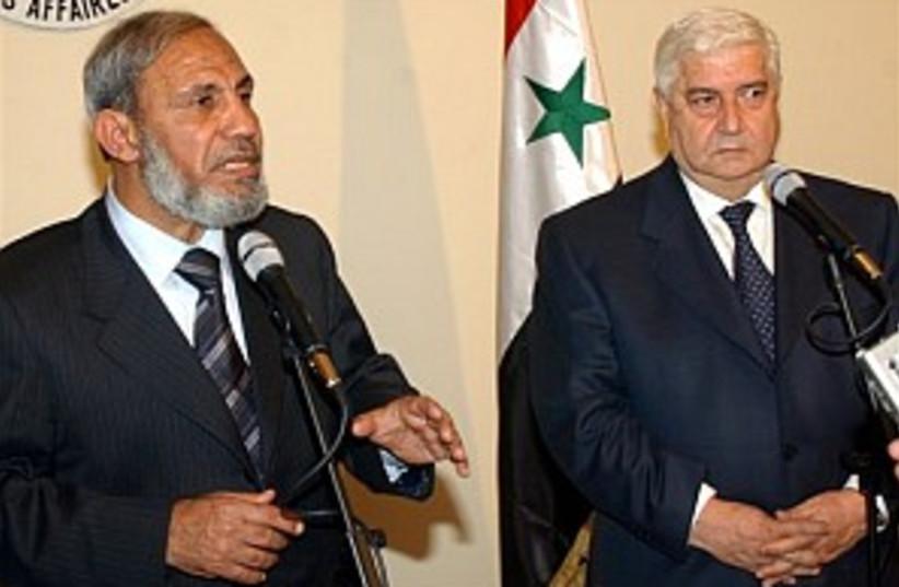 zahar and Syrian FM 298  (photo credit: AP)