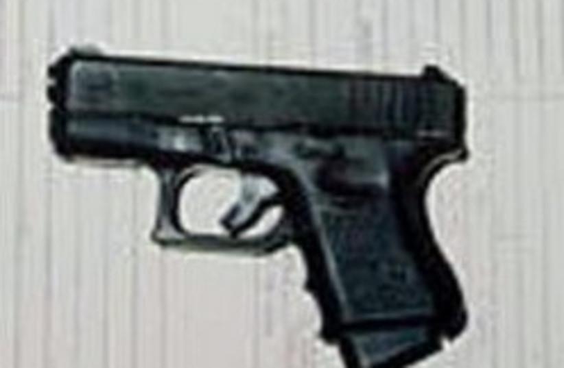 handgun pistol glock 248 88 (photo credit: AP)