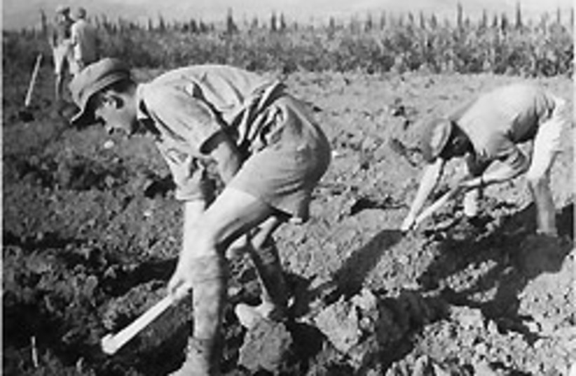 early kibbutz workers 88 248 (photo credit: Jerusalem Post Archives)